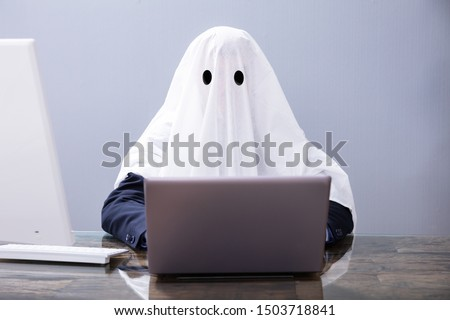 Ghostwriter Writing Article On Laptop In Office
