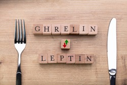 Ghrelin And Leptin Hormones Controlling Hunger Levels Near Fork And Knife