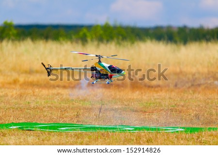 Giannitsa, Greece - June 8 : National aeromodelling race, F3C aerobatic helicopters, nitro, gasoline and electric remote control models on June 8, 2013 in Giannitsa, Greece.