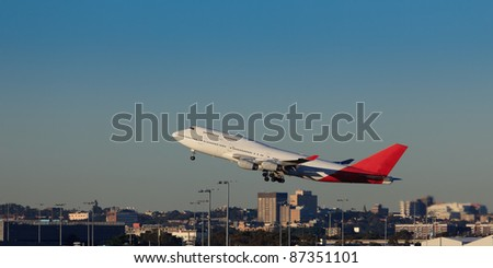 giant airplane departures sydney airport over city buildings take-off land