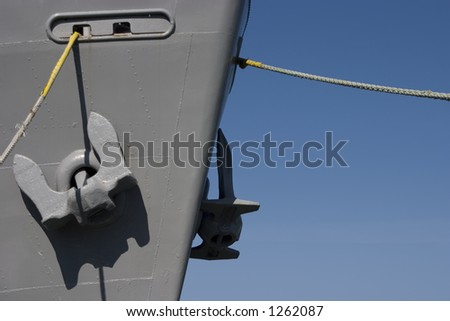 Giant Anchors hang from the bow of a ship.