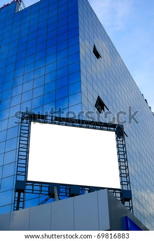 giant blank billboard, display on a skyscraper in a big city for advertising