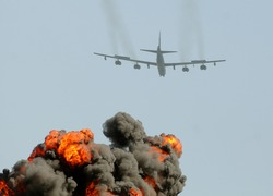 Giant explosions behind heavy US Air Force bomber