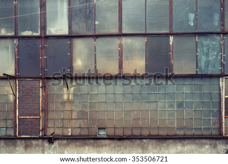 giant glass wall. rusty windows ...