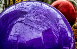 Giant glossy plastic balls in an outdoor setting