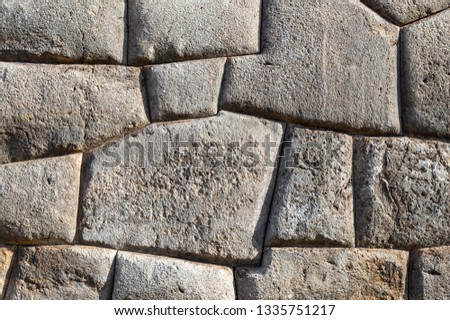 Giant granite boulders and the finest Inca stonework of the Inca civilization with an Inca wall in the archaeological ruin of Sacsayhuaman, Cusco City, Peru.