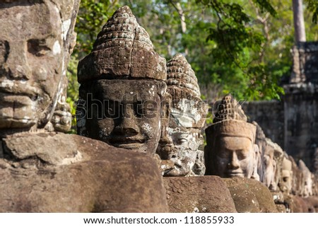 Giant guards in Angkor Thom front gate in Cambodia