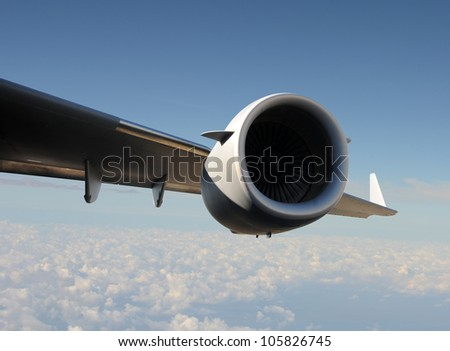 Giant jet engine and wing at high altitude
