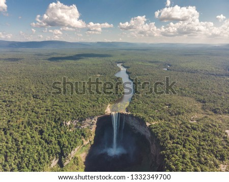 Giant Kaieteur Falls in Guyana. The lush green Amazon with a view of the river and waterfalls from above.