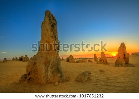 Giant limestone formation at dusk. The Pinnacles Desert in Nambung National Park, offers, at sunset, the show with the best colors. The Pinnacles is a major tourist attraction in Western Australia.