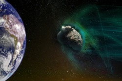 Giant meteorite in green light flies towards planet Earth, global space catastrophe concept. The elements of this image furnished by NASA