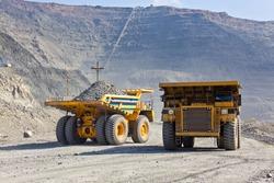 Giant Ore Trucks  in open pit mine
