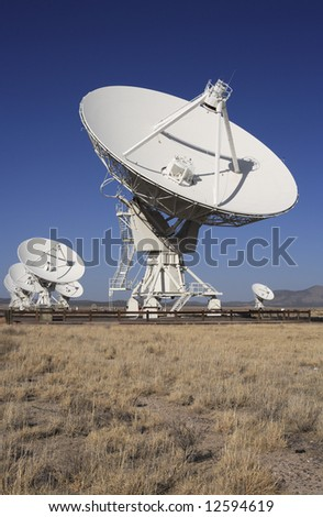 Giant radio telescopes in the Very Large Array, New Mexico. - stock photo