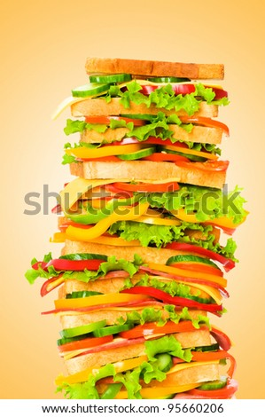 Giant sandwich against gradient background