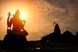 Giant sculpture of Shiva Nageshwar at the famous Nageshwar temple close to Dwarka. Gujarat. India.
