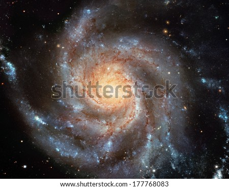 Giant spiral disk of stars, dust and gas is 170,000 light-years across. The spiral galaxy M101 is estimated to contain at least one trillion stars. Cleaned and retouched image, original by ESA-Hubble