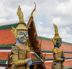 Giant statues at the Thai temple with blue sky and white cloud, Thailand.