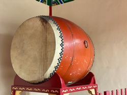 Giant Taiko in Asia budda temple with white background, Taiko drum has been incorporated in Japanese theatre for rhythmic needs, general atmosphere, and in certain settings decoration
