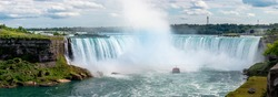 Giant Water Falls with Mist coming of Cruise Ship tourist Ship Niagara Falls on the US Canadian Border in North America