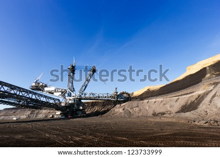 Giant wheel of bucket wheel excavator in a brown coal open pit.