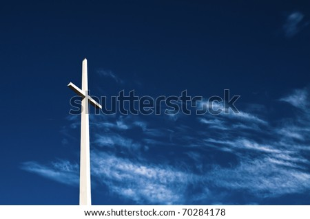 Giant white cross on deep blue sky