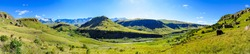 Giants Castle South Africa scenic green Drakensberg mountains -  beautiful, idyllic and impressive green ultra wide panorama with sunny blue sky,fairy tale like, mountains,valley,creek,wanderlust