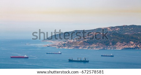 Gibraltar strait with passing tankers at sunny day #672578581