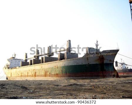 GIDDANI, PAKISTAN - DEC 08: A big ship George Lyras anchors for breaking at Giddani Ship Breaking Yard on December 08, 2011.