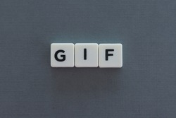 GIF word made of square letter word on grey background.