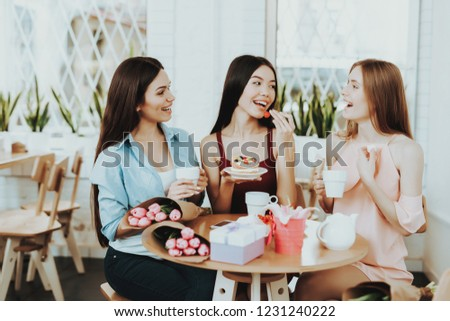 Gift And Happy Time. Drinking tea and Good Mood. Charming. Happiness with Friends. Beautiful Flowers and Good Mood. Present and Good Mood with Young Friends. Beautiful Dress and Happiness Springtime.