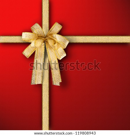 Gift and present wrapping box with Gold ribbon and red paper