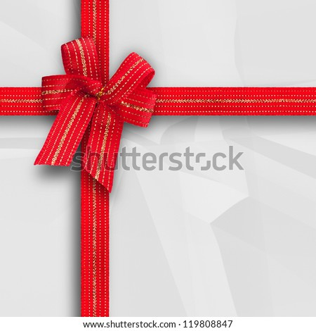 Gift and present wrapping box with red ribbon and white paper