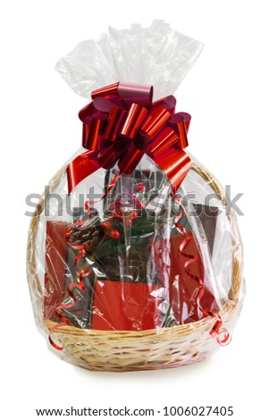 gift basket packed in transparent paper with a big red bow isolated on a white background Stockfoto ©