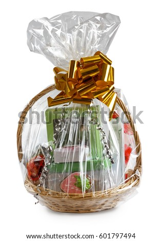 gift basket packed in transparent paper with a big yellow bow isolated on a white background Stockfoto ©