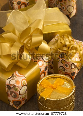 gift bixes witg bows on the wooden table