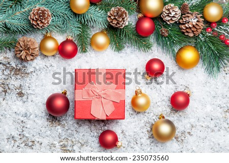 gift box and branch with toys.