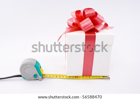 Gift box and measure tape - stock photo