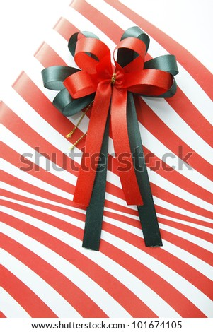 Gift box and Red ribbon on white background