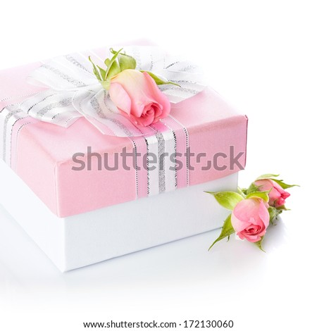 Gift box and roses. Festive surprise. Box with a bow. Elegant gift.