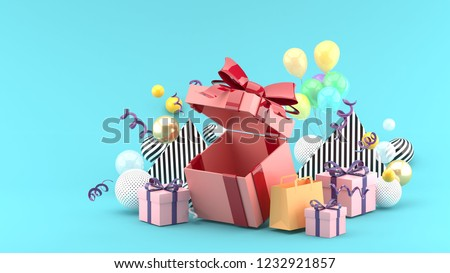 Gift Box and Shopping Bag amid colorful balls on blue background.-3d rendering.
