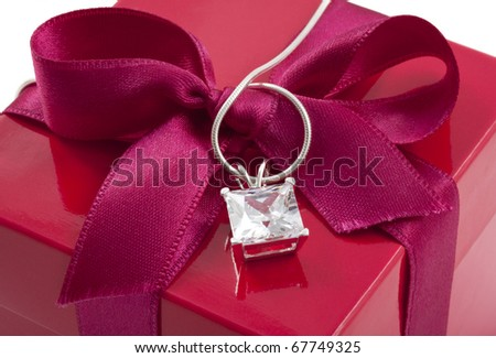 Gift box close up with diamond on necklace