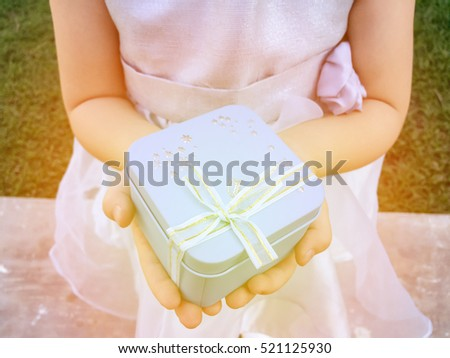 Gift box on girl\'s hands .Blue box in girl\'s hand.Surprise gift box.