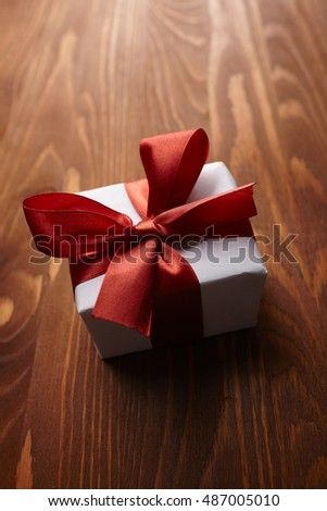 gift box on the wooden background #487005010