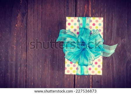 Gift box on wooden background - vintage old effect style pictures