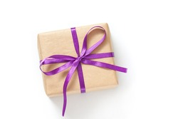 Gift box, parcel in wrapping paper  tied with purple ribbon, packaging mock up