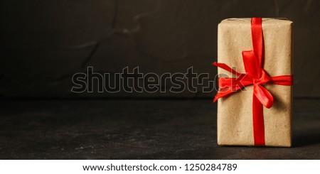 Gift Box, Ribbon - Kraft Paper (dark background). top view, copy spac #1250284789