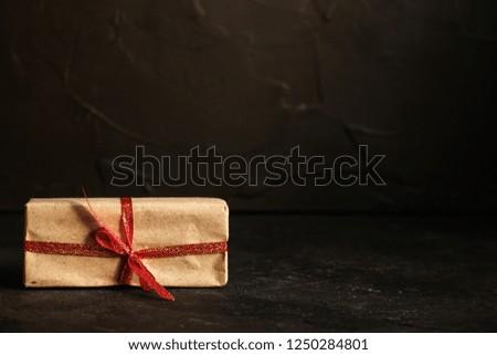 Gift Box, Ribbon - Kraft Paper (dark background). top view, copy spac #1250284801