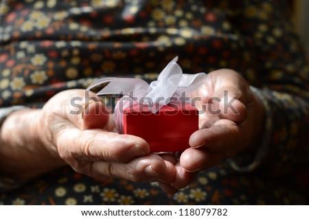 gift box senior person's hands