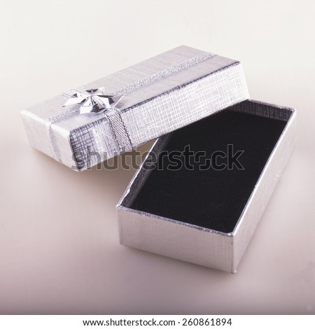 Gift box silver and black open and empty