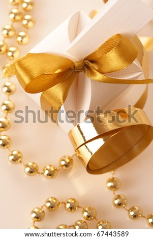 gift box tied with a gold ribbon bow